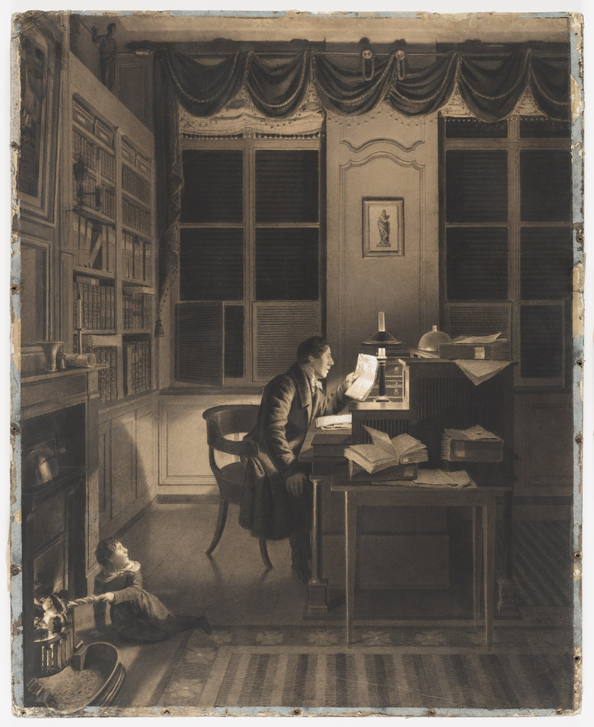 Interior with a man reading at his desk